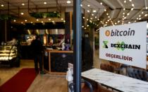 """A sign at the entrance door of a kebab restaurant reads """"We accept Bitcoin, Dexchain"""" in Istanbul"""