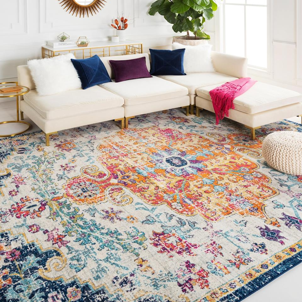 "<h2>Hauteloom Bodrum Saffron Area Rug</h2> <p>This colorful area rug with pops of teal, navy, garnet, and burnt orange will liven up your living room. It's available in several color schemes, including blue, grey, and white.</p> <p>SHOP NOW: <a href=""https://www.amazon.com/Updated-Traditional-Rectangle-Polypropylene-Charcoal/dp/B07H1B9LCQ/"" rel=""nofollow"">Amazon</a>, $221</p>"