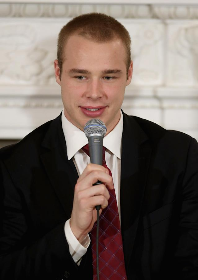 WASHINGTON, DC - MARCH 26: National Hockey League Stanley Cup winning Los Angeles Kings player Dustin Brown participates in a question-and-andwer session with students in the State Dining Room of the White House March 26, 2013 in Washington, DC. Players from the Kings and the Major League Soccer champion LA Galaxy participated in a question-and-answer panel with students from across the country and Sam Kass, Assistant White House Chef and Executive Director of first lady Michelle Obama's health program LetÕs Move! (Photo by Chip Somodevilla/Getty Images)