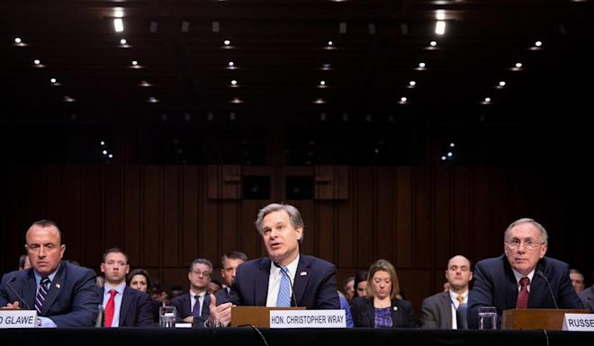 Christopher Wray, FBI director (centre), speaks while David Glawe, under secretary at the US Department of Homeland Security (left), and Russell Travers, acting director at the National Counterterrorism Centre, listen during a Senate Homeland Security Committee hearing. Photo: Bloomberg