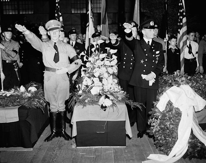 <p>German Nazis give the salute as they stand beside the casket of Capt. Ernest A. Lehmann, former commander of the zeppelin Hindenburg, during funeral services held on the Hamburg-American pier in New York City, May 11, 1937. The caskets of the 28 Germans who lost their lives in the Hindenburg disaster May 6 will be placed on board the Hamburg for their return to Europe. (AP Photo/Anthony Camerano) </p>