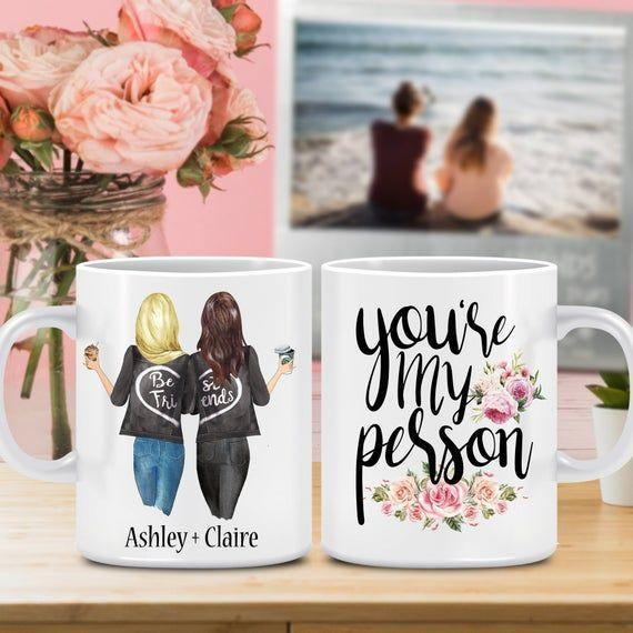 """<p><strong>MugsBuddies</strong></p><p>etsy.com</p><p><strong>$12.95</strong></p><p><a href=""""https://go.redirectingat.com?id=74968X1596630&url=https%3A%2F%2Fwww.etsy.com%2Flisting%2F903996838%2Fcustom-friend-mug-best-friend-gift&sref=https%3A%2F%2Fwww.thepioneerwoman.com%2Fholidays-celebrations%2Fgifts%2Fg32161232%2Fbest-friend-gifts%2F"""" rel=""""nofollow noopener"""" target=""""_blank"""" data-ylk=""""slk:Shop Now"""" class=""""link rapid-noclick-resp"""">Shop Now</a></p><p>This mug has two cute aspects: the calligraphed """"you're my person""""message on the front and a customized portrait on the back. You can pick the drink, hair color, and more. </p>"""