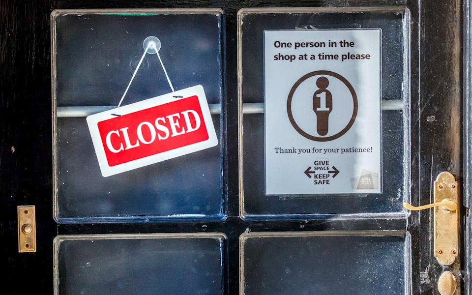 A closed sign in a shop window