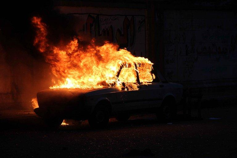A car burns during clashes between supporters and opponents of Egyptian President Mohamed Morsi outside Cairo University on July 3, 2013. Egypt was on edge Wednesday after President Mohamed Morsi refused to quit hours before an army ultimatum expires, following deadly violence during rival mass protests in Egypt's worst crisis since its 2011 revolution