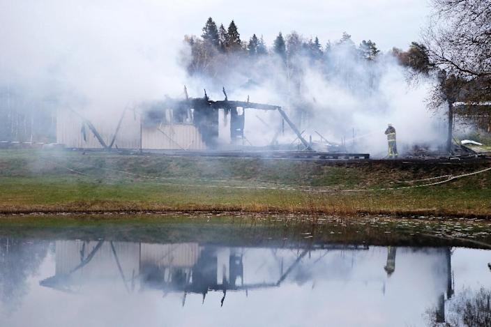 Firefighters work to extinguish a fire that broke out early in the morning on October 20, 2015 at a centre for asylum seekers near Munkedal in Sweden (AFP Photo/Adam Ihse)