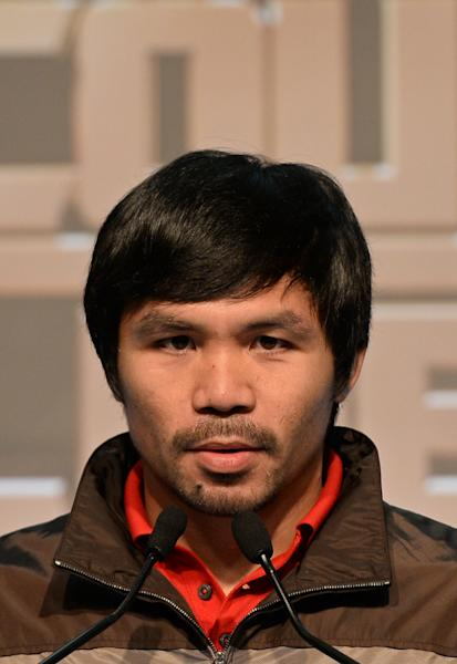 Philippine boxing icon Manny Pacquiao speaks during a pre-fight press conference in Macau, August 25, 2014 (AFP Photo/Dale de la Rey)