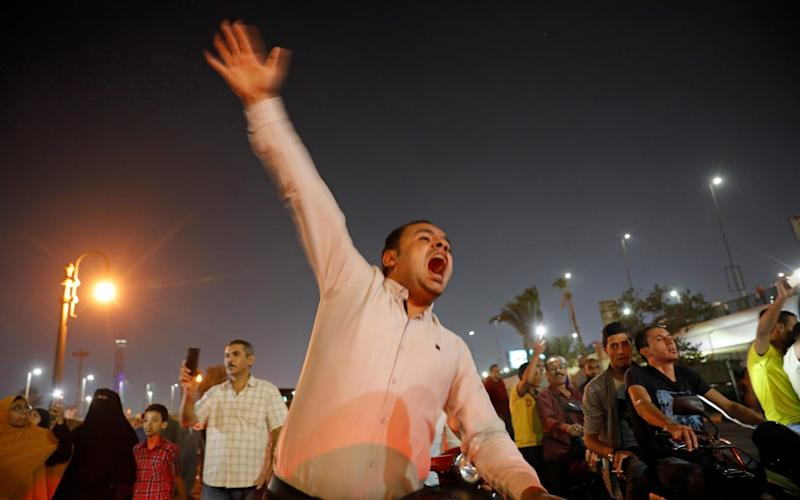 Small groups of protesters gather in central Cairo shouting anti-government slogans in Cairo - REUTERS