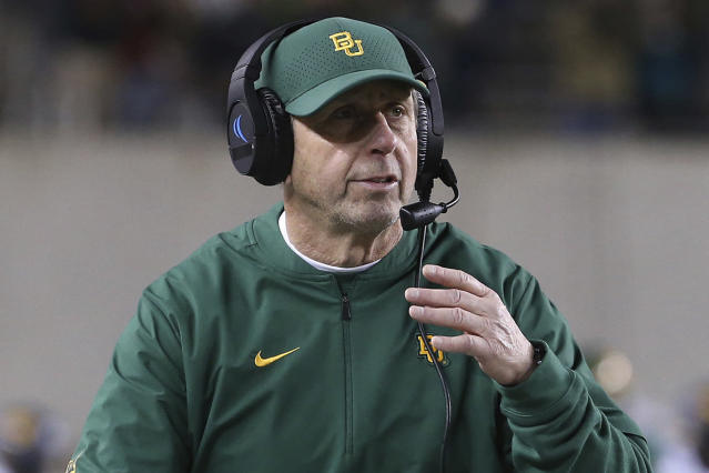 FILE - In this Oct. 31, 2019, file photo, Baylor defensive coordinator Phil Snow walks the sideline in an NCAA college football game against West Virginia in Waco, Texas. Carolina Panthers new defensive coordinator Phil Snow has a monumental task ahead of him, returning the once proud Carolina defense to among the best in the league without retired linebacker Luke Kuechly. Carolina's defense is coming off a season in which they allowed 29.4 points per game, the second-most in the league. (AP Photo/Jerry Larson, File)