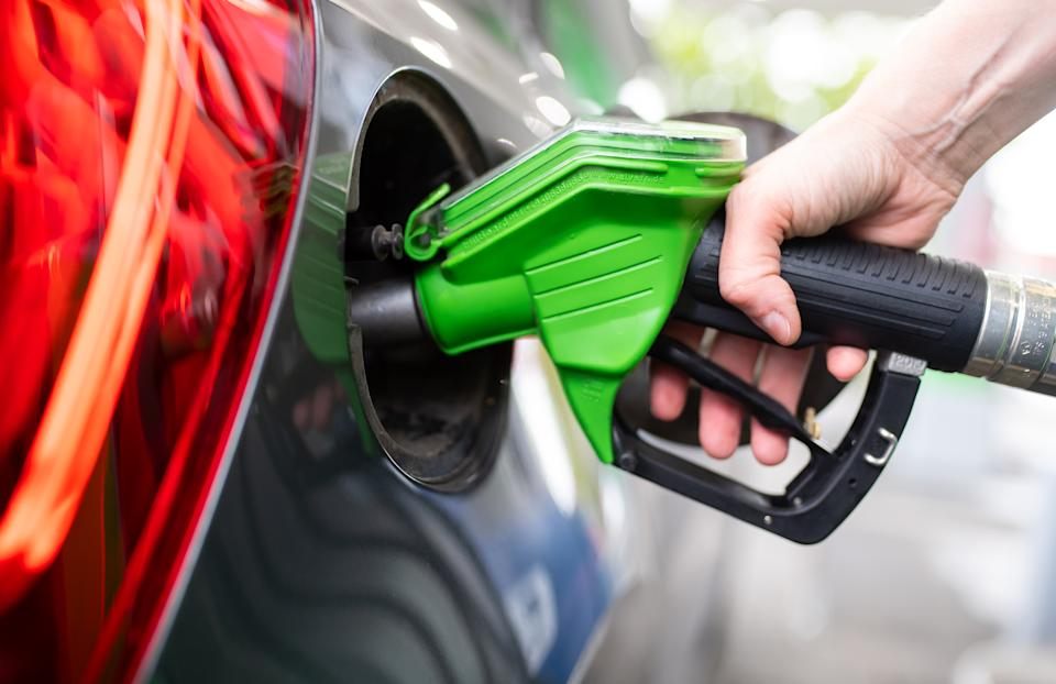 06 September 2020, Bavaria, Munich: A woman holds a pump nozzle in her hand at a gas station and refuels a car. Photo: Sven Hoppe/dpa (Photo by Sven Hoppe/picture alliance via Getty Images)
