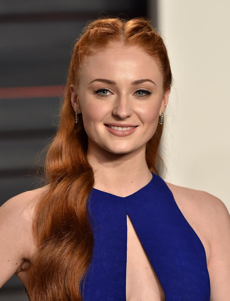 <p>Turner's copper French plaits that flowed down into long waves were the main focus of her look at the Vanity Fair Oscar Party.</p>