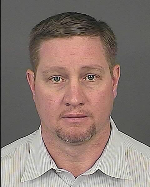 A photo released by the Denver police shows Franklin Sain.  Sain was charged Monday March 4, 2013, with attempting to influence a public servant, a felony, as well as harassment-ethnic intimidation, a misdemeanor, for emails, voicemails and a letter sent to Democratic Rep. Rhonda Fields.   (AP Photo/Denver police)