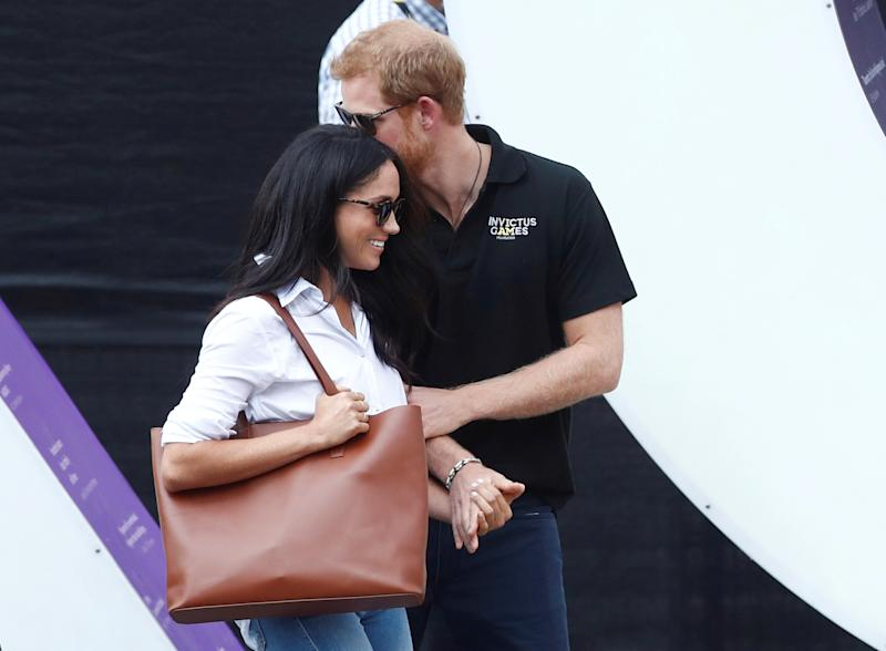 Britain's Prince Harry (R) arrives with girlfriend actress Meghan Markle at the wheelchair tennis event during the Invictus Games in Toronto, Ontario, Canada September 25, 2017. REUTERS/Mark Blinch TPX IMAGES OF THE DAY