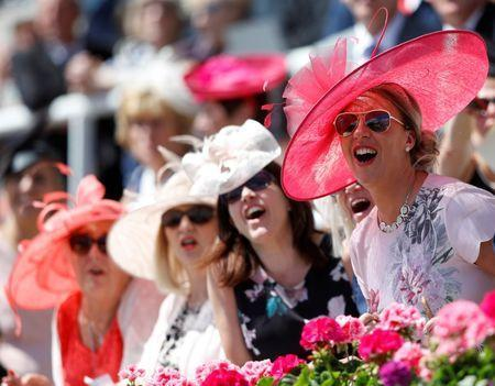 Horse Racing - Royal Ascot - Ascot Racecourse, Ascot, Britain - June 21, 2018 Racegoers cheer during the 2.30 Norfolk Stakes REUTERS/Peter Nicholls