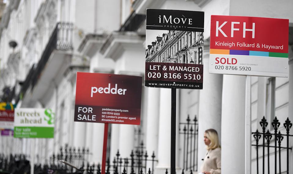 "Estate Agents' ""For Sale"", ""Sold"", and "" To-Let"" boards are pictured outside residential properties in south London on July 6, 2020. - British media reported Monday that Britain's Chancellor of the Exchequer Rishi Sunak is set to outline plans to raise the threshold at which homebuyers pay Stamp Duty on their new properties, currently set at GBP 125,000. (Photo by DANIEL LEAL-OLIVAS / AFP) (Photo by DANIEL LEAL-OLIVAS/AFP via Getty Images)"