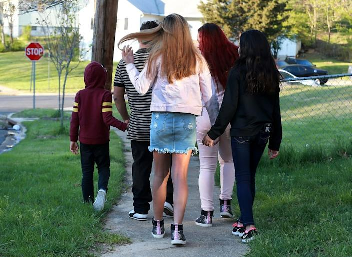"""Jose walks with his children, who were recently released from a government shelter where they had been held for more than two months. <span class=""""copyright"""">(Kirk McKoy / Los Angeles Times)</span>"""