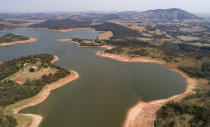 A general view of the Jaguari dam, which is part of the Cantareira System, responsible for providing water to the Sao Paulo metropolitan area, in Braganca Paulista, Brazil, Wednesday, Aug. 25, 2021. Water levels plunged during the drought season, bringing concerns about the water supply to the largest Brazilian metropolitan area. (AP Photo/Andre Penner)
