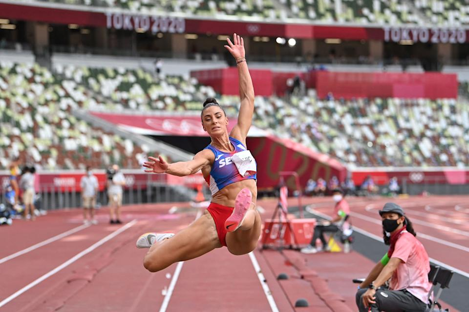 <p>Serbia's Ivana Spanovic competes in the women's long jump final during the Tokyo 2020 Olympic Games at the Olympic Stadium in Tokyo on August 3, 2021. (Photo by Andrej ISAKOVIC / AFP)</p>