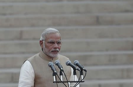 India's Prime Minister Narendra Modi takes his oath at the presidential palace in New Delhi