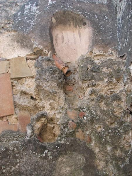 A pipe leading in from the side likely provided flush water for this upstairs toilet in Pompeii.