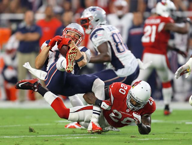 <p>New England Patriots wide receiver Julian Edelman (11) is tackled by Arizona Cardinals linebacker Deone Bucannon (20) in the first quarter at University of Phoenix Stadium. Mandatory Credit: Mark J. Rebilas-USA TODAY Sports </p>