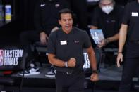 Miami Heat head coach Erik Spoelstra gestures as he watches play against the Boston Celtics during the second half of an NBA conference final playoff basketball game, Thursday, Sept. 17, 2020, in Lake Buena Vista, Fla. (AP Photo/Mark J. Terrill)