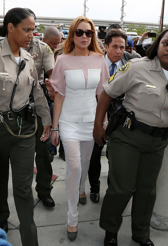 Lindsay Lohan arrives at court for the first day of her trial at Airport Courthouse.