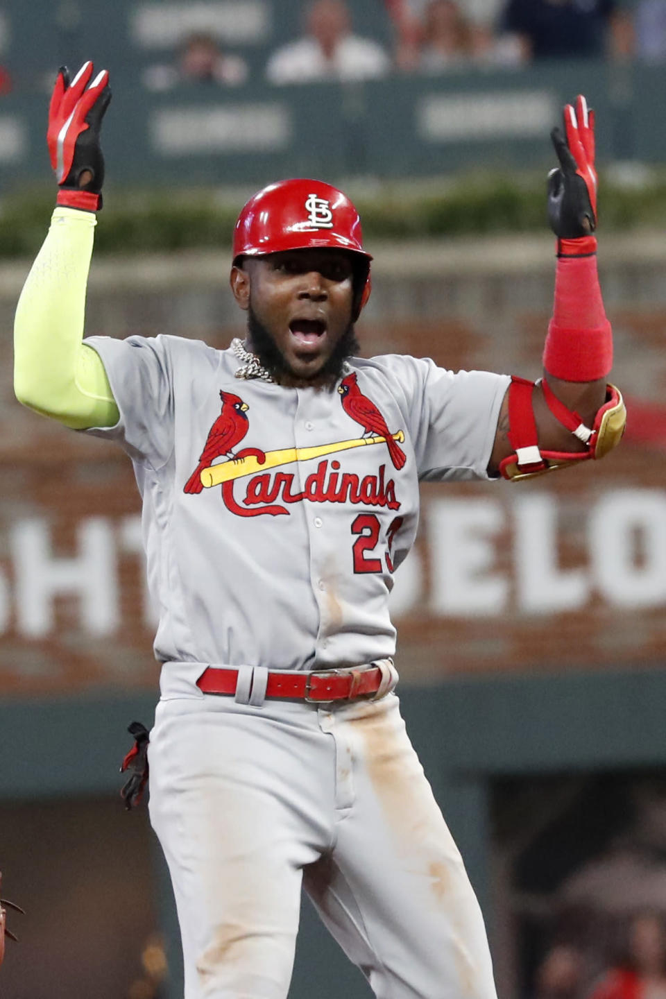 CORRECTS TO DOUBLE, INSTEAD OF SINGLE - St. Louis Cardinals' Marcell Ozuna celebrates his two-run double against the Atlanta Braves in the ninth inning during Game 1 of a best-of-five National League Division Series, Thursday, Oct. 3, 2019, in Atlanta. (AP Photo/John Bazemore)