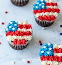 """<p>This decorating trick is genius: You just need a piping bag, red, white and blue frosting, and some star sprinkles to create an edible flag!</p><p><strong>Get the recipe at <a href=""""https://www.kenarry.com/american-flag-cake-fourth-july-cupcakes/"""" rel=""""nofollow noopener"""" target=""""_blank"""" data-ylk=""""slk:Kenarry"""" class=""""link rapid-noclick-resp"""">Kenarry</a>.</strong></p><p><a class=""""link rapid-noclick-resp"""" href=""""https://go.redirectingat.com?id=74968X1596630&url=https%3A%2F%2Fwww.walmart.com%2Fsearch%2F%3Fquery%3Dstand%2Bmixer&sref=https%3A%2F%2Fwww.thepioneerwoman.com%2Ffood-cooking%2Frecipes%2Fg36343624%2F4th-of-july-cupcakes%2F"""" rel=""""nofollow noopener"""" target=""""_blank"""" data-ylk=""""slk:SHOP STAND MIXERS"""">SHOP STAND MIXERS</a></p>"""