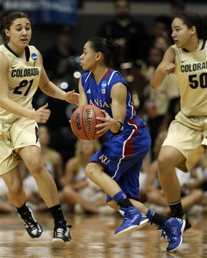 Kansas guard Angel Goodrich, center, drives between Colorado guard Jasmine Sborov (21) and forward Jamee Swan (50) during the first half of a first-round women's NCAA college basketball game on Saturday, March 23, 2013, in Boulder, Colo. (AP Photo/Brennan Linsley )