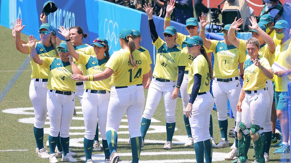 Australia's softball players, pictured here after being beaten by Japan.