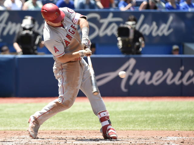 Los Angeles Angels' Mike Trout (27) connects for a solo home run against the Toronto Blue Jays during the fifth inning of a baseball game in Toronto, Thursday, May 24, 2018. (nathanDenette/The Canadian Press via AP)