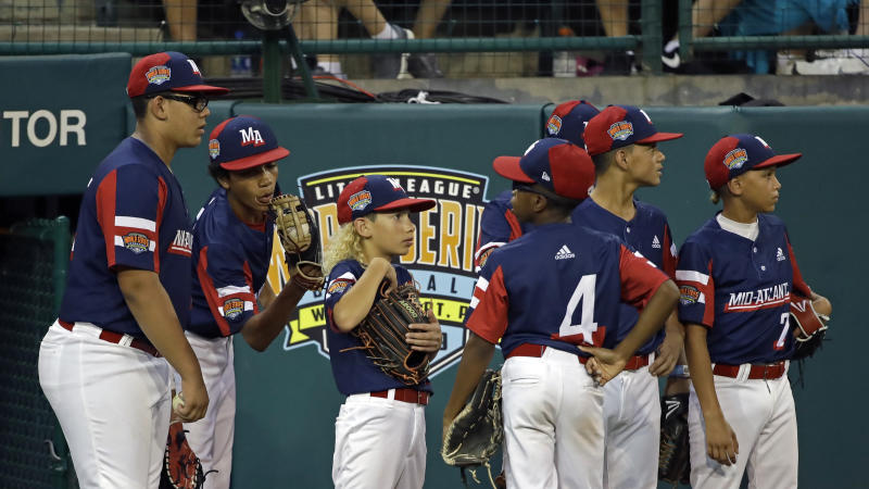 The Elizabeth, New Jersey Little League team waits to take the field against Barrington, Rhode Island during the second inning of a baseball game at the Little League World Series tournament in South Williamsport, Pa., Tuesday, Aug. 20, 2019. Elizabeth, New Jersey won the game 2-0. (AP Photo/Tom E. Puskar)