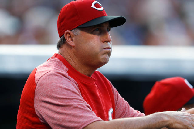 FILE - In this July 5, 2017, file photo, Cincinnati Reds manager Bryan Price reacts after starting pitcher Scott Feldman walks Colorado Rockies' Carlos Gonzalez to put two runners on base in the first inning of a baseball game, in Denver. The Reds have fired Bryan Price after a 3-15 start, the first managerial change in the major leagues this season. Price was in his fifth season leading the rebuilding team. The Reds have lost at least 94 games in each of the last three seasons while finishing last in the NL Central. Bench coach Jim Riggleman will manage the team on an interim basis. (AP Photo/David Zalubowski, File)