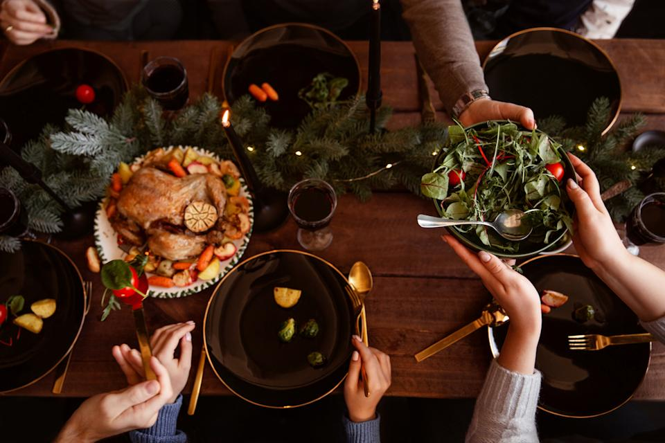 People pace plates as they share Christmas dinner together.