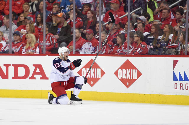 Columbus Blue Jackets right wing Cam Atkinson (13) celebrates his goal during the second period in Game 2 of an NHL first-round hockey playoff series against the Washington Capitals, Sunday, April 15, 2018, in Washington. (AP Photo/Nick Wass)