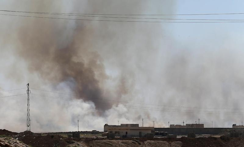 Smoke billows from an area controlled by jihadist militants from the Islamic State of Iraq and the Levant (ISIL), in Bashir, 20 km south of Kirkuk, on June 23, 2014 (AFP Photo/Karim Sahib)