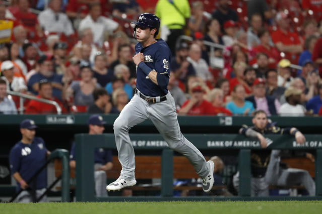 Milwaukee Brewers' Christian Yelich runs in to score on a double by Keston Hiura during the fourth inning of a baseball game Wednesday, Aug. 21, 2019, in St. Louis. (AP Photo/Jeff Roberson)
