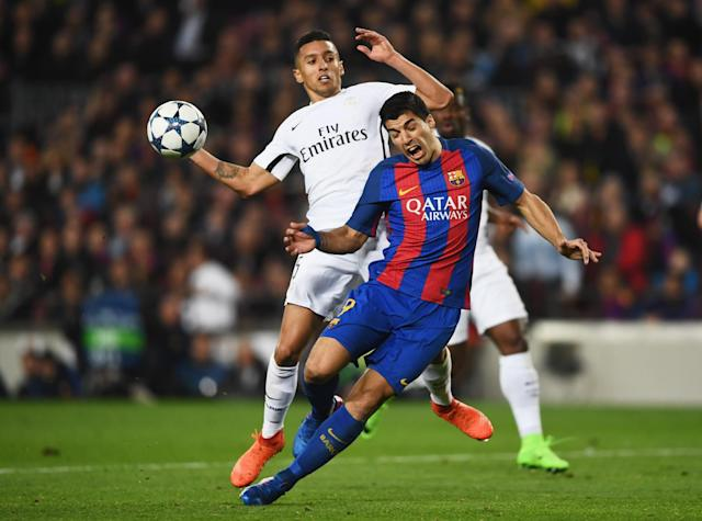 <p>Luis Suarez of Barcelona is challenged by Marquinhos of PSG for a penalty during the UEFA Champions League Round of 16 second leg match between FC Barcelona and Paris Saint-Germain at Camp Nou on March 8, 2017 in Barcelona, Spain. (Photo by Laurence Griffiths/Getty Images) </p>