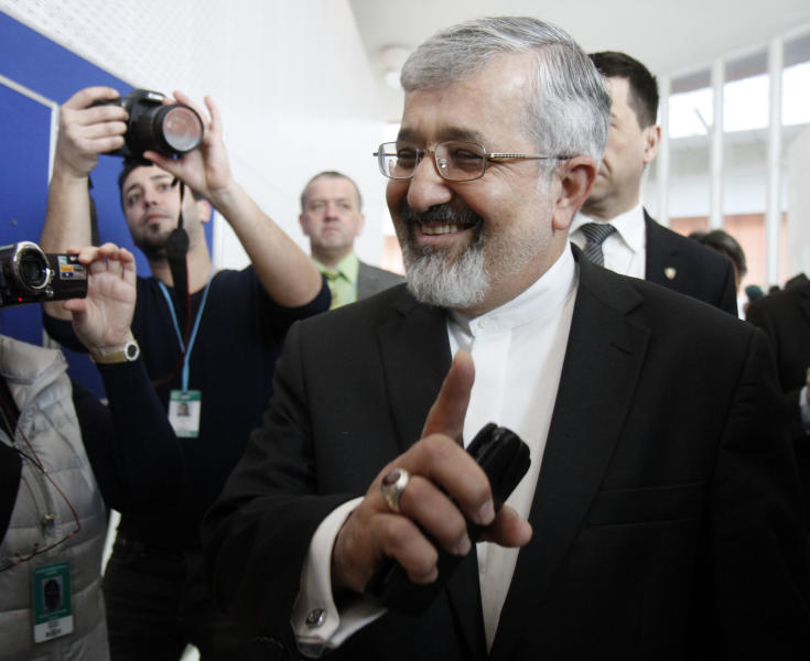 Iran's ambassador to the International Atomic Energy Agency, IAEA, Ali Asghar Soltanieh is surrounded by media when arriving for the IAEA board of governors meeting at the International Center, in Vienna, Austria, on Wednesday, March 7, 2012. (AP Photo/Ronald Zak)