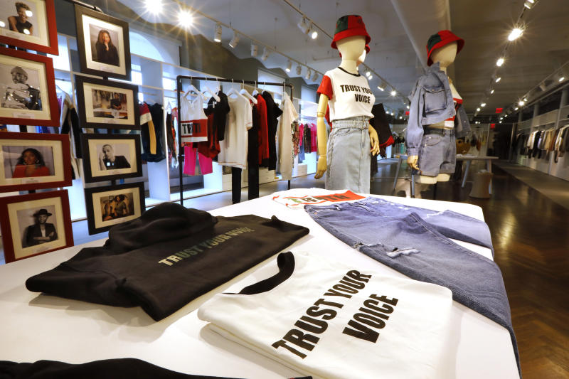 """In this Feb. 20, 2020, photo, items from H&M's new street wear collection are displayed at a store in New York. The collection was designed in collaboration with Ruth Carter, the Academy-Award winning designer behind the costumes for films such as """"Black Panther"""" and """"Malcolm X."""" It debuted as more companies and brands are getting into the business of Black History Month but also trying not to leave the impression that African American consumers are important just once a year. (AP Photo/Richard Drew)"""