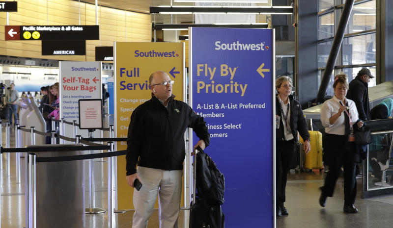A traveler waits to check in with Southwest Airlines at Seattle-Tacoma International Airport, Wednesday, March 13, 2019, in Seattle. According to an airport spokesman, Southwest is the only carrier flying in and out of the airport with flights that use the Boeing 737 MAX 8 airplane, and that is limited to a few flights per day. President Donald Trump said Wednesday that the U.S. is issuing an emergency order grounding all Boeing 737 Max 8 and Max 9 aircraft in the wake of the crash of an Ethiopian Airliner that killed 157 people. (AP Photo/Ted S. Warren)