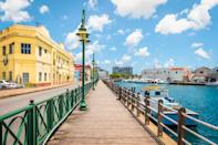 With tourism being the mainstay of the Caribbean nation, and with the pandemic affecting it dearly, Barbados has launched the Barbados Welcome Stamp programme under which remote workers can apply to live and work on the Island for 12 months. The tropical paradise has only seen 200 cases so far of the COVID-19, and 7 deaths. <br><strong>Eligibility: </strong>Applicants need to show an expected income of atleast USD 50,000 for the next 12 months. The cost is USD 2,000 for solo travellers and USD 3,000 for families. Visa status will be confirmed in five working days.