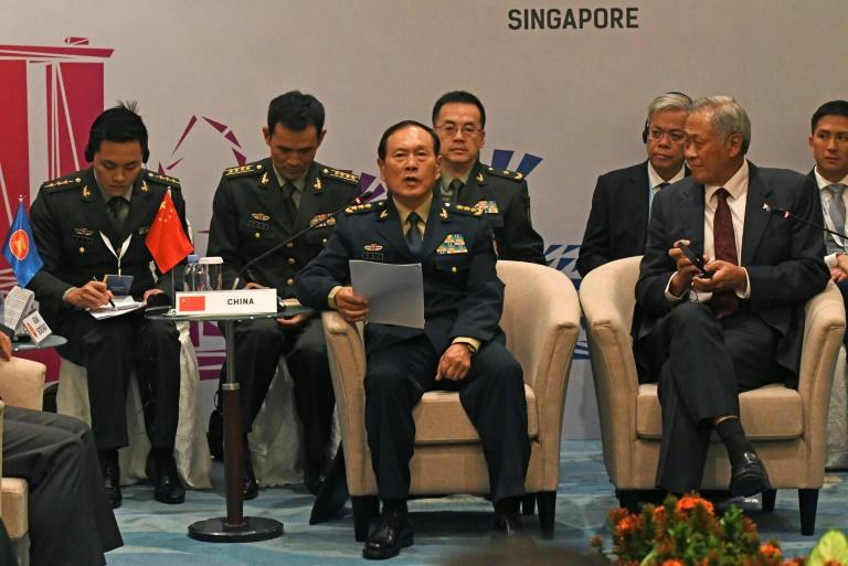 Singaporean defence minister Ng Eng Hen (R) announced the exercises on Friday