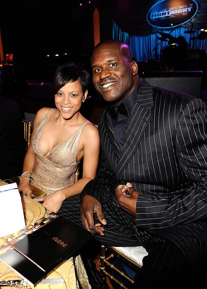 """Shaquille O'Neal squeezes in for a shot with his beautiful wife Shaunie. Although Shaq filed for divorce from Shaunie last September, it looks like the couple may have worked things out! Michael Caulfied/<a href=""""http://www.wireimage.com"""" target=""""new"""">WireImage.com</a> - April 5, 2008"""