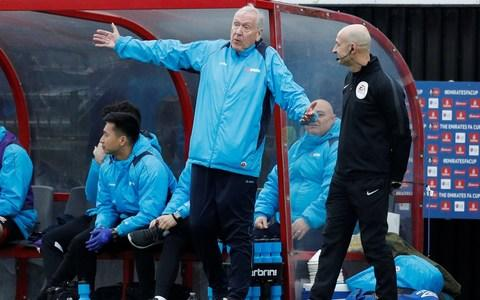 Martin Tyler talks to the fourth official - Credit: Reuters