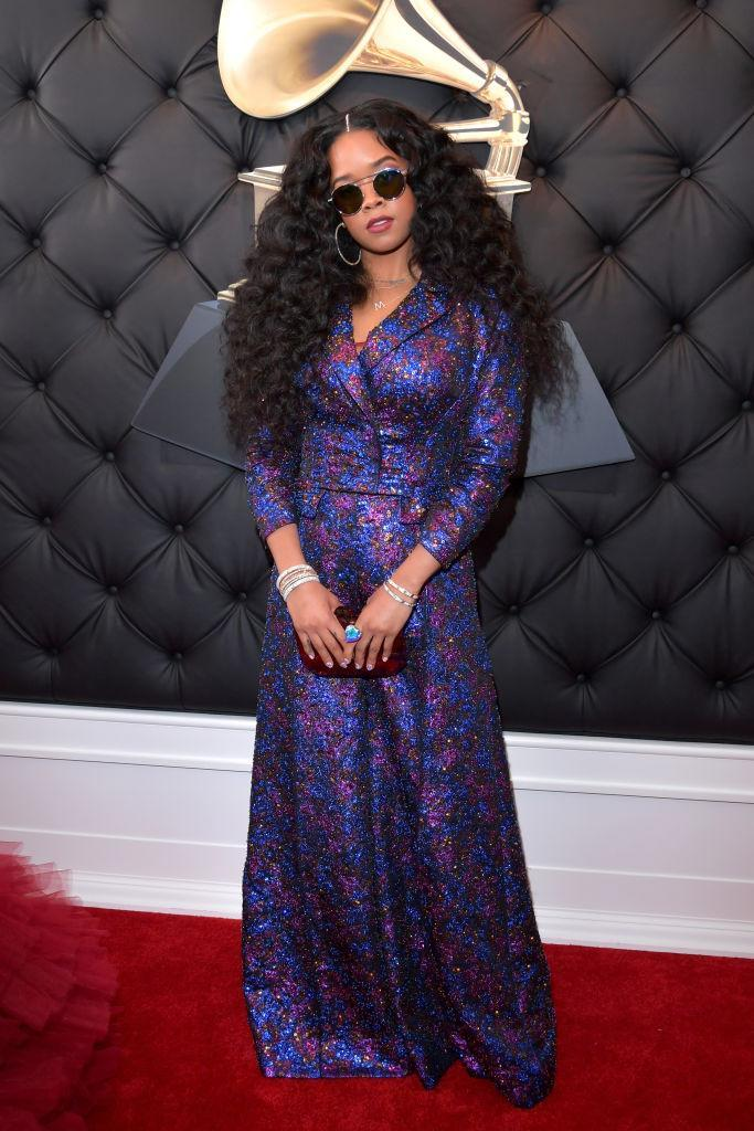 <p>H.E.R. — real name Gabi Wilson — was gorgeous in a purple and blue print and some celebrity-worthy shades. </p>