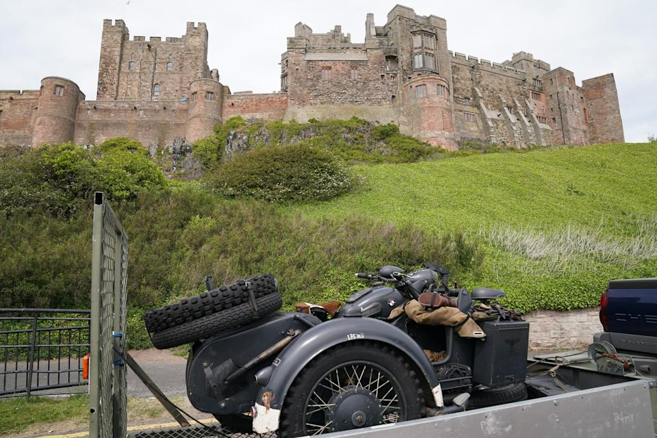 A replica SS motorbike is driven into the grounds of Bamburgh Castle in Northumberland, which is being used as a filming location for what is believed to be the new Indiana Jones 5 movie. Picture date: Monday June 7, 2021. (Photo by Owen Humphreys/PA Images via Getty Images)