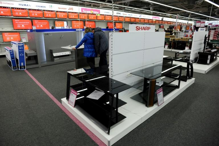 Even when the rouble was falling, Russian consumers tended to snap up electronics, furniture and cars before prices soared (AFP Photo/OLGA MALTSEVA)