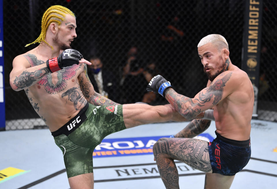 LAS VEGAS, NEVADA - AUGUST 15: (L-R) Sean O'Malley kicks Marlon Vera of Ecuador in their bantamweight bout during the UFC 252 event at UFC APEX on August 15, 2020 in Las Vegas, Nevada. (Photo by Jeff Bottari/Zuffa LLC)