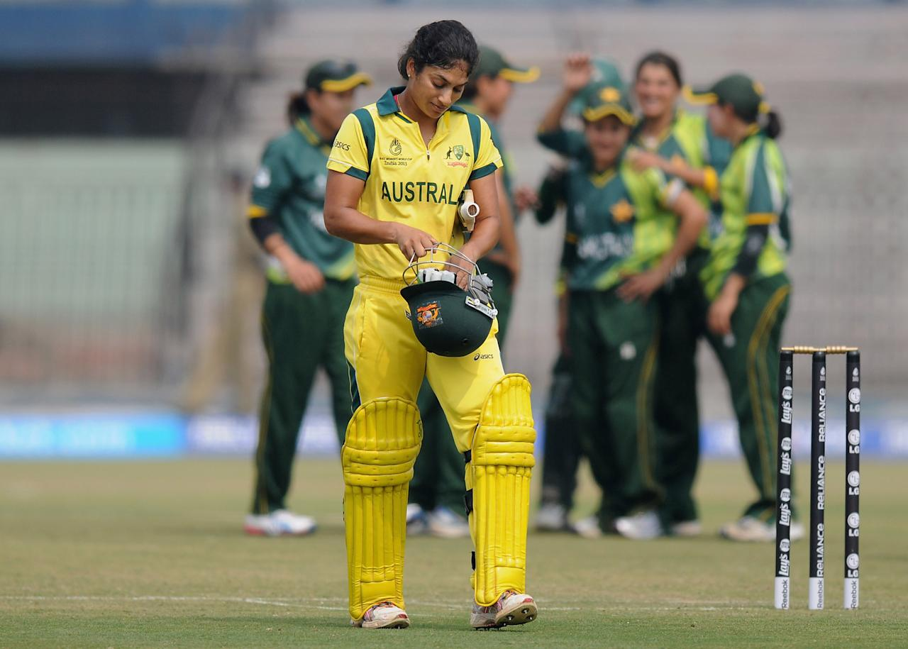 CUTTACK, INDIA - FEBRUARY 01: Lisa Sthalekar of Australia walks back after getting out during the second match of ICC Womens World Cup between Australia and Pakistan, played at the Barabati stadium on February 1, 2013 in Cuttack, India.  (Photo by Pal Pillai-ICC/ICC via Getty Images)